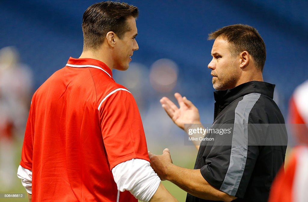 Coaches Brady Quinn, left, and Mike Alstott of the East Team talk during the first half of the East West Shrine Game at Tropicana Field on January 23, 2016 in St. Petersburg, Florida.