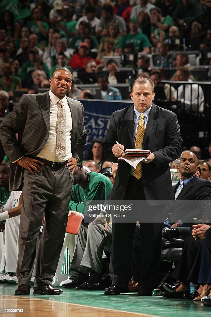 Coaches Doc Rivers and Tom Thibodeau of the Boston Celtics watch their team play against the Orlando Magic in Game Three of the Eastern Conference...