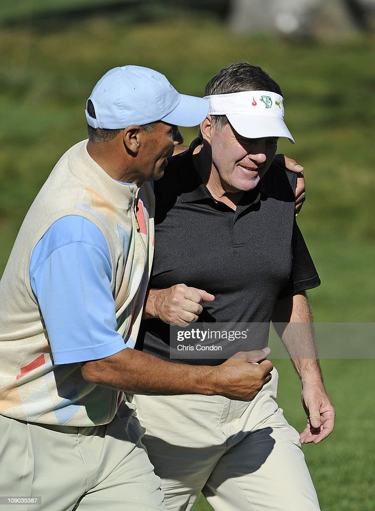 NFL coaches Herm Edwards and Bill Belichick share a laugh on the 5th green during the third round of the ATT Pebble Beach National ProAm at Pebble...