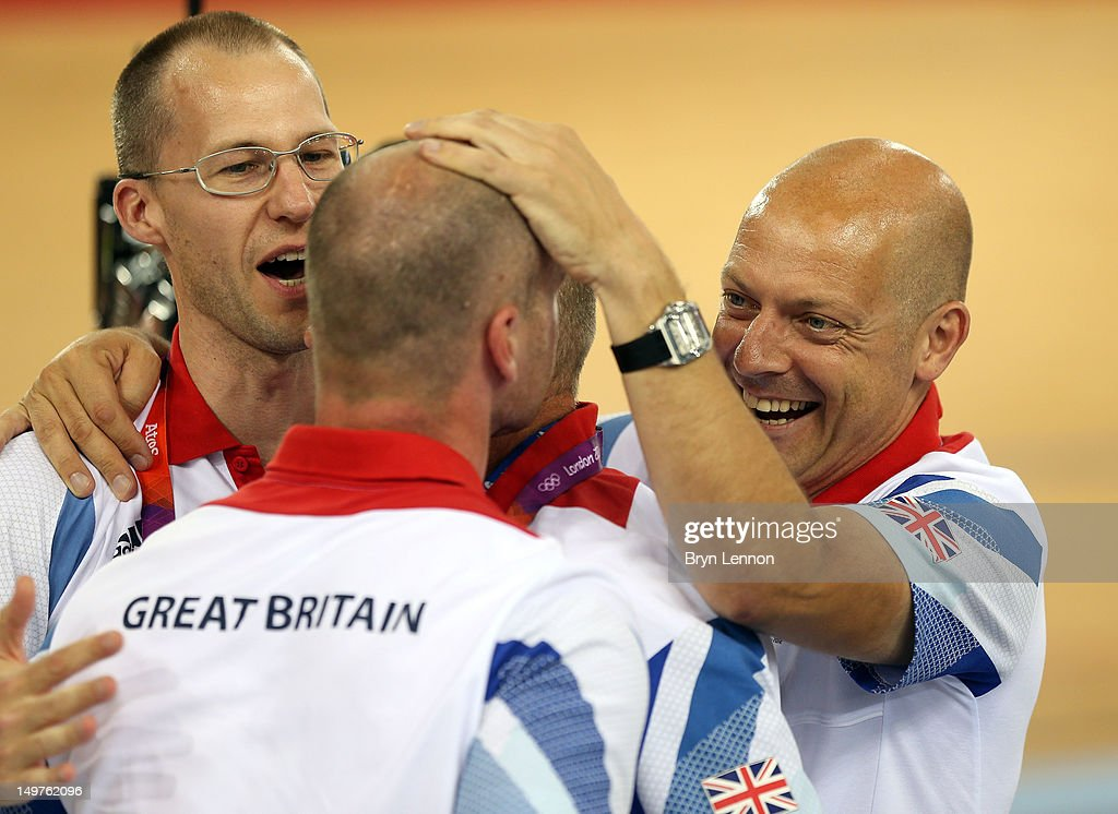 Coaches Iain Dyer (L) and Jan van Eijden celebrate with British Cycling Performance Director, Dave Brailsford after Victoria Pendleton of Great Britain's gold medal-winning display in the Women's Keirin Track Cycling final on Day 7 of the London 2012 Olympic Games at Velodrome on August 3, 2012 in London, England.