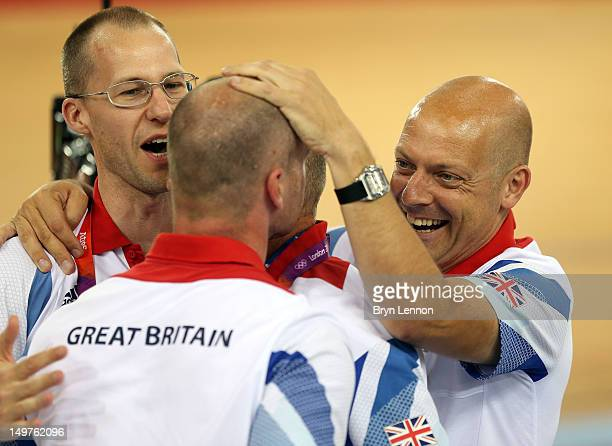 Coaches Iain Dyer and Jan van Eijden celebrate with British Cycling Performance Director Dave Brailsford after Victoria Pendleton of Great Britain's...