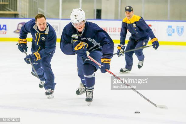 Coaches joke with Buffalo Sabres Center Casey Mittelstadt during onice practice at the Buffalo Sabres Development Camp on July 10 at HarborCenter in...