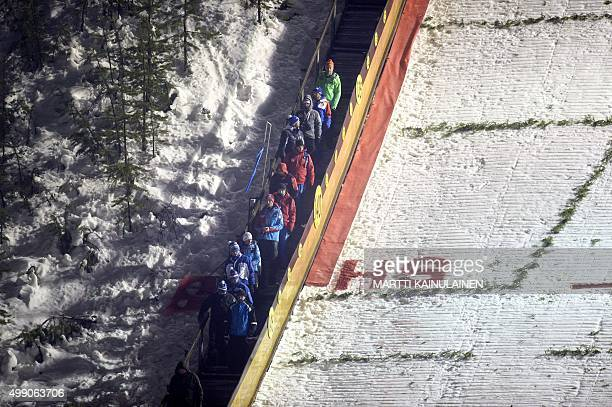 Coaches leave the hill at the FIS Ruka Nordic 2015 in Kuusamo Northern Finland on November 28 2015 Ski jumping competition in Ruka was canceled due...