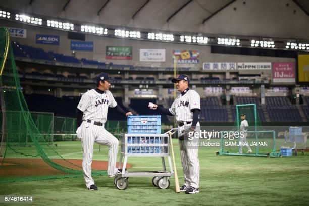 Coaches Makoto Kaneko and Masaji Shimizu of Japan talk prior to the Eneos Asia Professional Baseball Championship 2017 game between Japan and South...