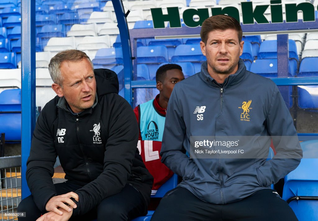 Coaches Neil Critchley (left) and Steven Gerrard of Liverpool during the UEFA Champions League group E match between Liverpool FC and Sevilla FC at Prenton Park on September 13, 2017 in Birkenhead, United Kingdom.