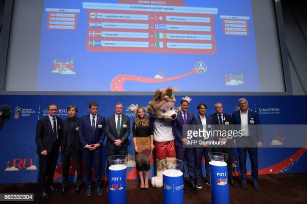 Coaches pose with the World Cup 2018 mascot under the results of the FIFA football World Cup 2018 European playoff draw on October 17 2017 in Zurich...
