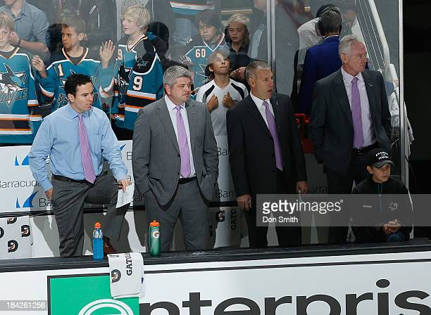 Coaches Todd McLellan Larry Robinson Jay Woodcroft and Jim Johnson of the San Jose Sharks support Hockey Fights Cancer before a game against the...