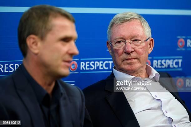 Coaching Ambassador Sir Alex Ferguson listens to Dynamo Kiev's coach Serguei Rebrov prior to a press conference closing a meeting of the Elite...