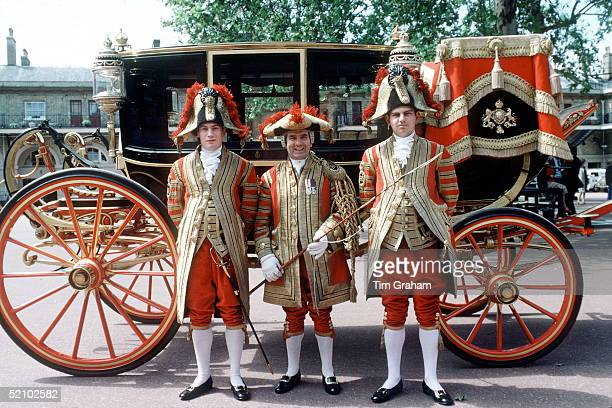 Coachmen In State Livery By The Glass Coach At The Royal Mews Buckingham Palace