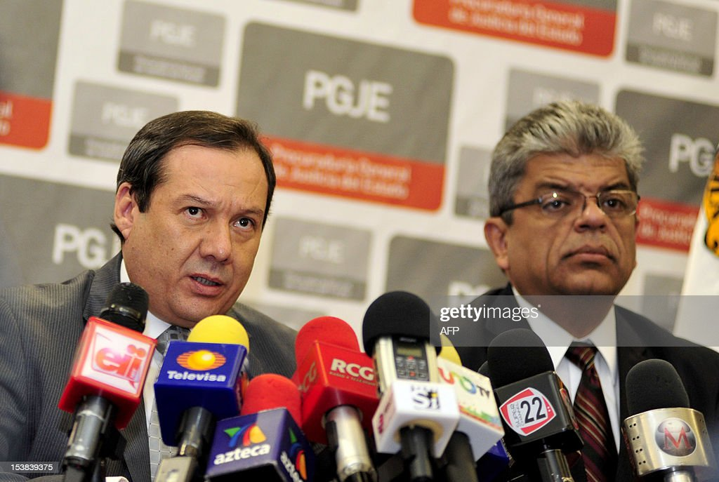 Coahuila state prosecutor Homero Ramos (L), accompanied by member of his staff Gerardo Villareal (R), speaks during a press conference regarding the death of the founder of the Zetas drug cartel Heriberto Lazcano , in Saltillo, state of Coahuila, Mexico, on October 9, 2012. The body of the Lazcano was stolen from a funeral parlor by an armed group after he was killed in a shootout with authorities in northern Mexico, officials said Tuesday. AFP PHOTO/Julio Cesar Aguilar