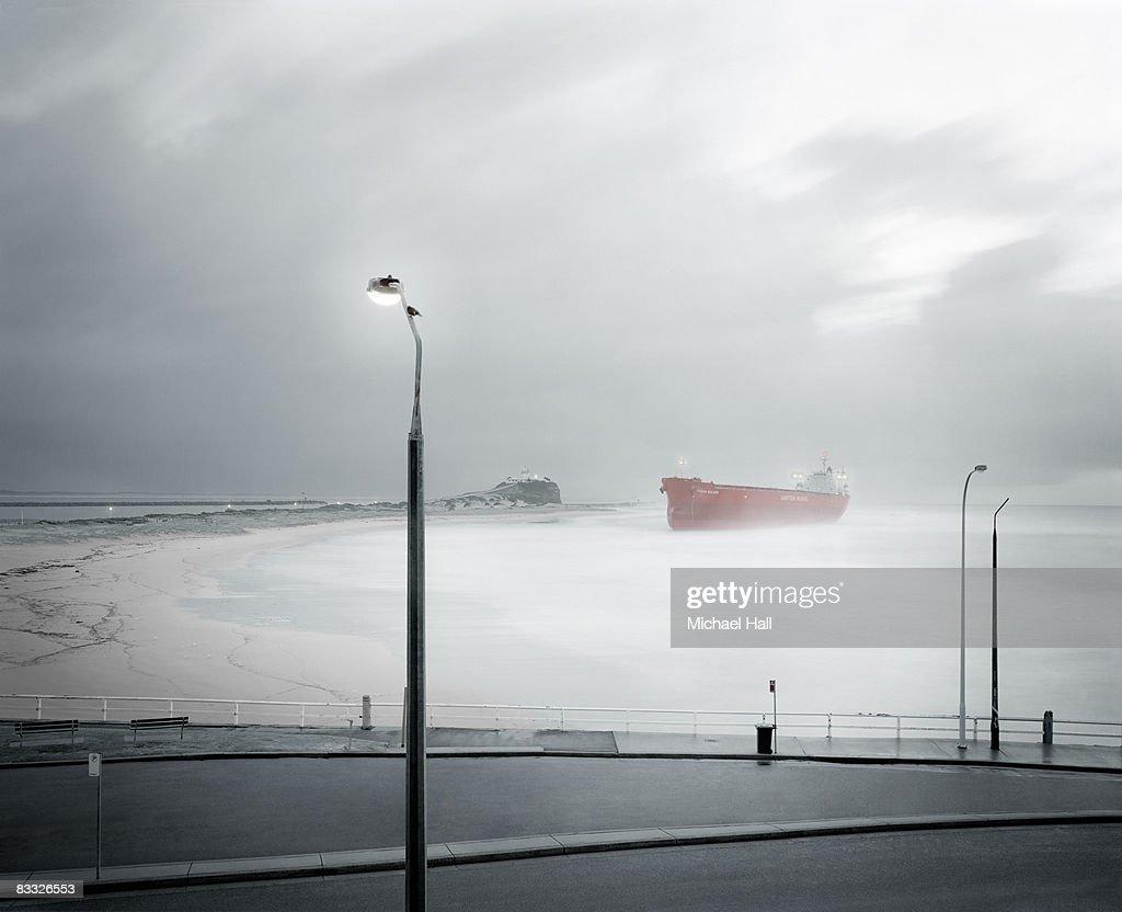 Coal carrier aground on beach : Stock Photo
