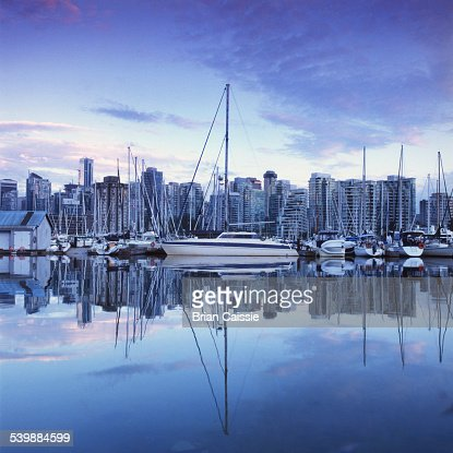 Coal harbor and cityscape at dusk