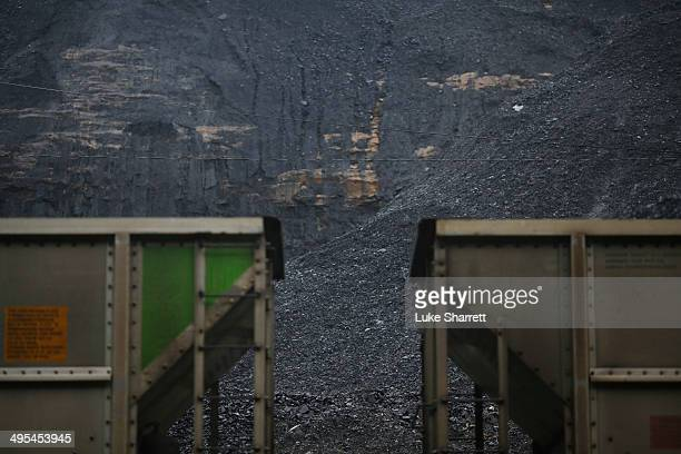 Coal harvested from a strip mine sits behind a pair of coupled coal cars on the grounds of Blackhawk Mining LLC Spurlock Prep Plant on June 3 2014 in...