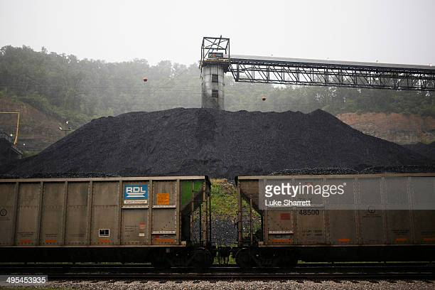 Coal hoppers sit coupled on a spur track in front of a coal tower at Blackhawk Mining LLC Spurlock Prep Plant on June 3 2014 in Printer Kentucky New...