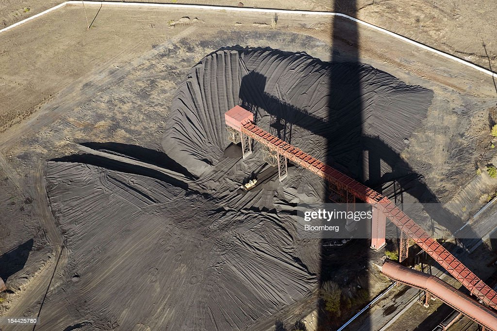 Coal is seen in a storage area in this aerial view at the Vostok Energo power plant, operated by the Donbass Fuel & Energy Co., or DTEK, in Donetsk, Ukraine, on Thursday, Oct. 18, 2012. DTEK, Ukraine's largest private coal and energy producer, signed a supply contract with OAO OGK-2, the Russian wholesale power generator controlled by OAO Gazprom. Photographer: Vincent Mundy/Bloomberg via Getty Images