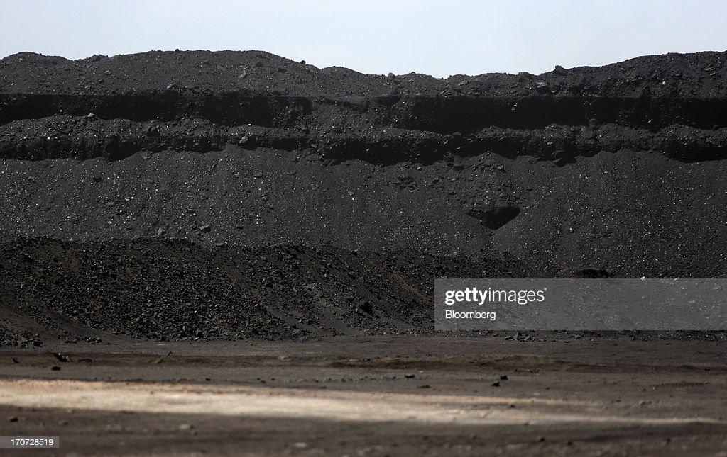 Coal is stacked at a reloading facility on the border with China in South Gobi, Mongolia, on Thursday, June 6, 2013. Mongolia, a country of almost 2.9 million people, has some of the world's biggest undeveloped mineral reserves, including Oyu Tolgoi, a copper and gold mine, and Tavan Tolgoi, a coal deposit. Photographer: Tomohiro Ohsumi/Bloomberg via Getty Images