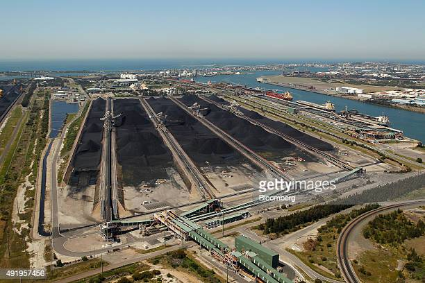 Coal is stockpiled at the Newcastle Coal Terminal in this aerial photograph taken in Newcastle Australia on Saturday Oct 3 2015 The slowdown across...