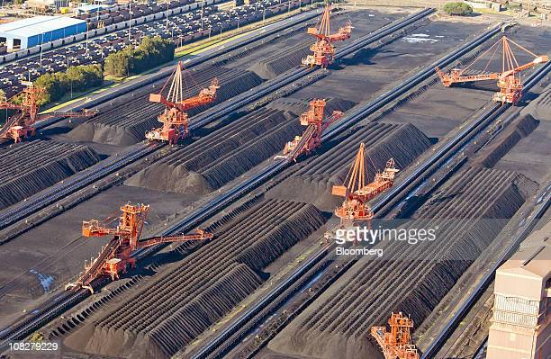 Coal is stockpiled in preparation for loading onto ships for export at the Newcastle Coal Terminal in Newcastle north of Sydney Australia on Monday...