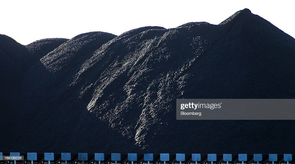 Coal is stockpiled in preparation for loading onto ships for export at the Newcastle Coal Terminal in Newcastle, north of Sydney, Australia, on Friday, May 3, 2013. Australia's forecast mining tax revenue has been downgraded, underscoring the 'grave' budget decisions facing Prime Minister Julia Gillard as the strength of the local dollar squeezes trade-exposed businesses. Photographer: Ian Waldie/Bloomberg via Getty Images