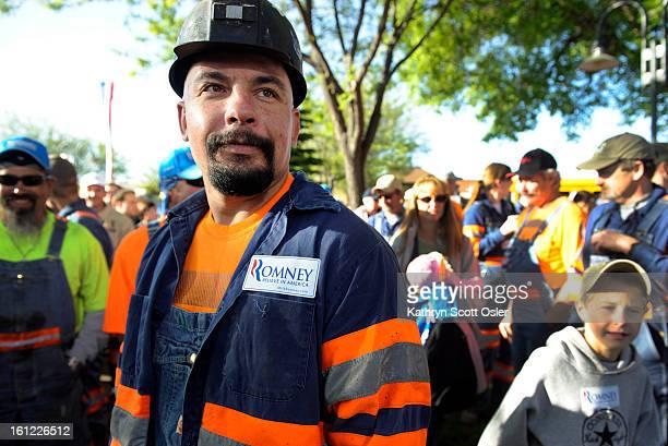 Coal miner Anthony Chenoweth and several of his colleagues from Peabody Energy show their support for presidential candidate Mitt Romney as he...