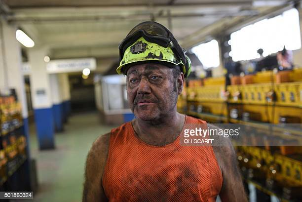 Coal miner Garry Ward is pictured in the Lamp Room after finishing the final shift before closure at the Kellingley Colliery in Yorkshire northern...