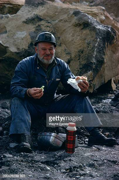 Coal miner having lunch, portrait