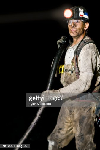Coal miner holding hose : Stock Photo