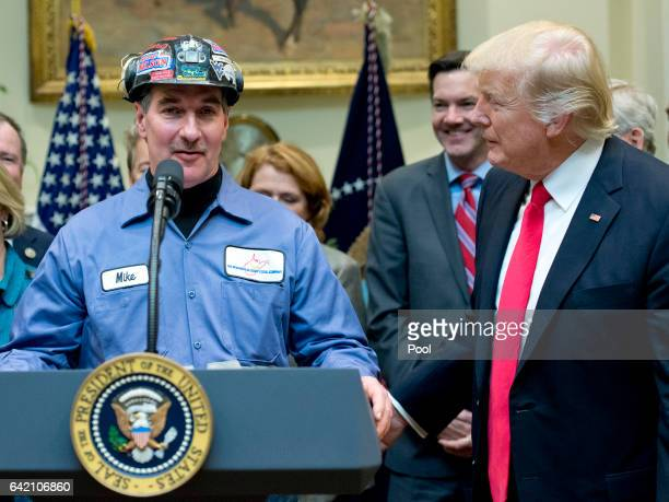 A coal miner identified only as Mike makes remarks prior to US President Donald Trump signing HJ Res 38 disapproving the rule submitted by the US...