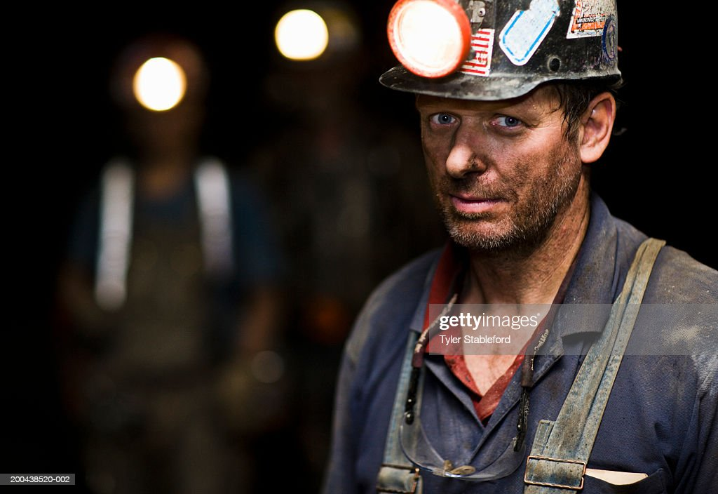 Coal miner in mine, portrait, close-up : Stock Photo