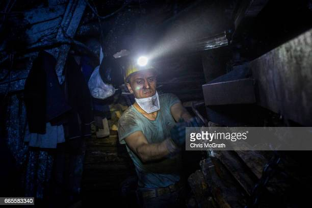 A coal miner is seen working in a tunnel at a large government run coal mine on April 4 2017 in Zonguldak Turkey More than 300 kilometers of coal...
