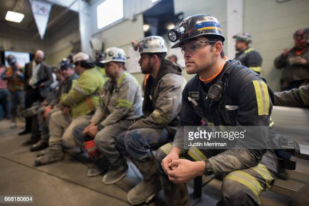 Coal miner Jaden Fredrickson of Cheat Lake WVa waits prior to the arrival of US Environmental Protection Agency Administrator Scott Pruitt who...