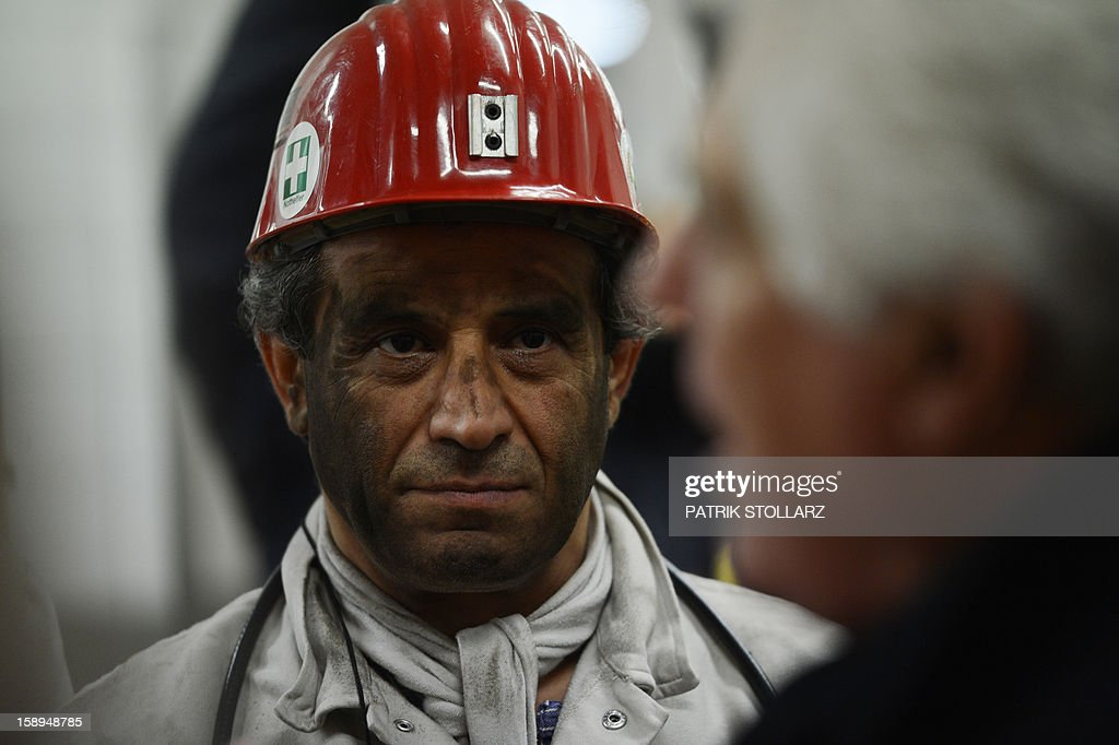 A coal miner leaves after his shift the mine Prosper Haniel Schacht 10 on January 4, 2013 in Bottrop, western Germany. AFP PHOTO / PATRIK STOLLARZ
