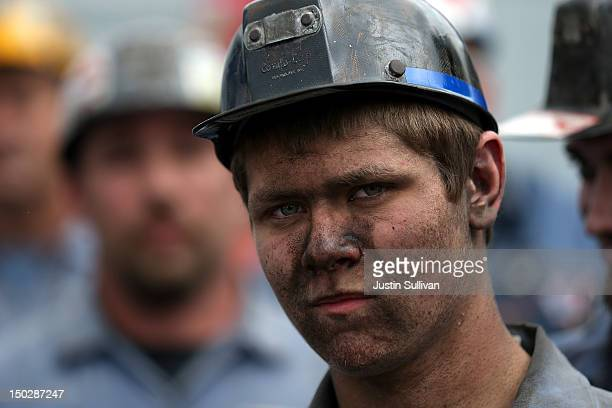 A coal miner looks on as Republican presidential candidate and former Massachusetts Governor Mitt Romney speaks during a campaign rally at American...