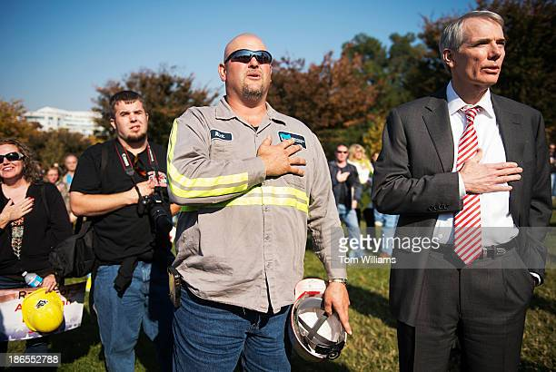 Coal miner Rick Baker of Belmont County Ohio and Sen Rob Portman ROhio recite the Pledge of Allegiance during the 'Stand up for American Energy Jobs'...
