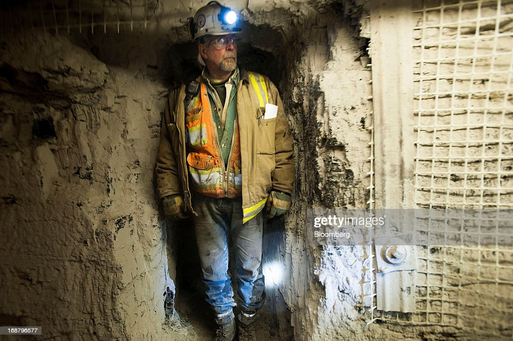 A coal miner stands in a crevice to avoid a transport car at the Consol Energy Bailey Mine in Wind Ridge, Pennsylvania, U.S., on Tuesday, May 14, 2013. Coal's prospects are improving after its share of U.S. power generation fell last year to 34 percent, the lowest since at least 1973, Energy Department data show. Hotter temperatures this summer that prompt American households to use more air conditioning will boost demand for coal and the railroads that ship it. Photographer: Ty Wright/Bloomberg via Getty Images