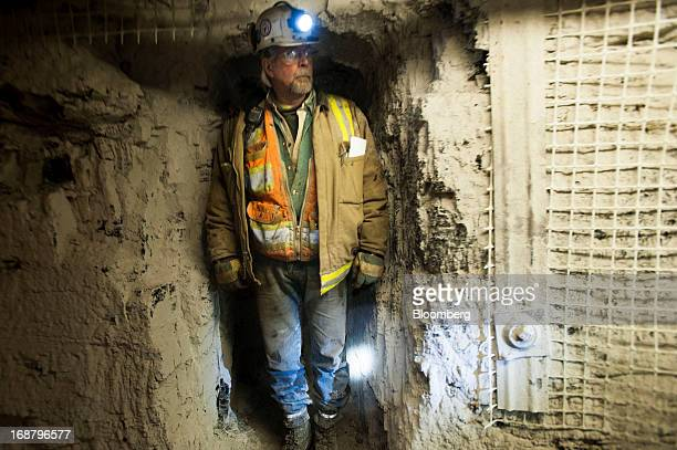 A coal miner stands in a crevice to avoid a transport car at the Consol Energy Bailey Mine in Wind Ridge Pennsylvania US on Tuesday May 14 2013...