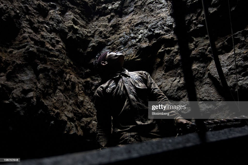 'BEST PHOTOS OF 2012' (): A coal miner stands in a mine in Jaintia Hills, Meghalaya, India, on Thursday, Feb. 2, 2012. India, reliant on coal for more than half its electricity, is struggling to ease blackouts as delays in adding railways hinder fuel supplies and discourage investors from building $36 billion of power plants. Photographer: Brent Lewin/Bloomberg via Getty Images