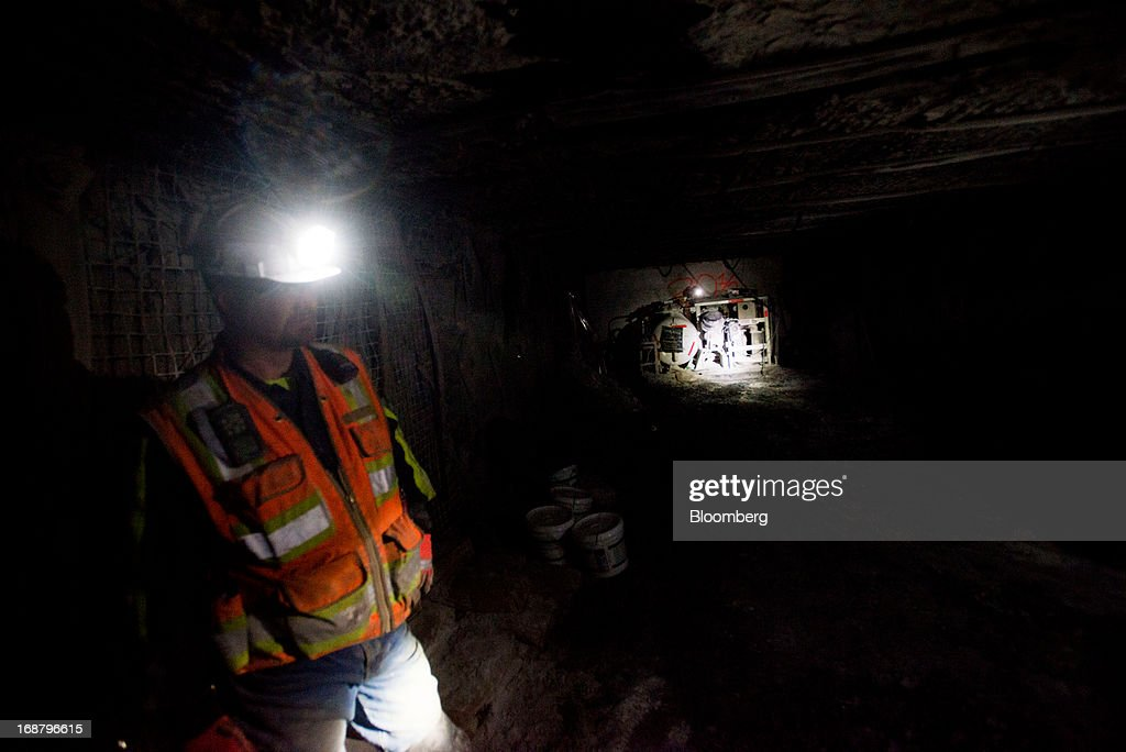 A coal miner uses his head lamp to illuminate a cross tunnel at the Consol Energy Bailey Mine in Wind Ridge, Pennsylvania, U.S., on Tuesday, May 14, 2013. Coal's prospects are improving after its share of U.S. power generation fell last year to 34 percent, the lowest since at least 1973, Energy Department data show. Hotter temperatures this summer that prompt American households to use more air conditioning will boost demand for coal and the railroads that ship it. Photographer: Ty Wright/Bloomberg via Getty Images