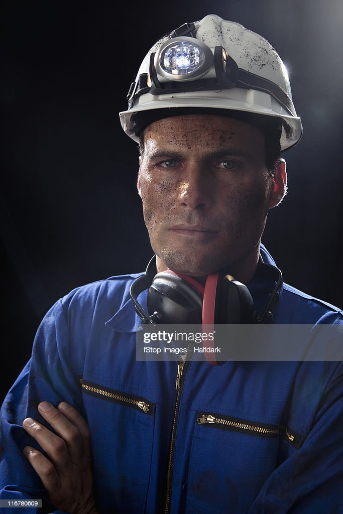 A coal miner with his arms crossed, portrait