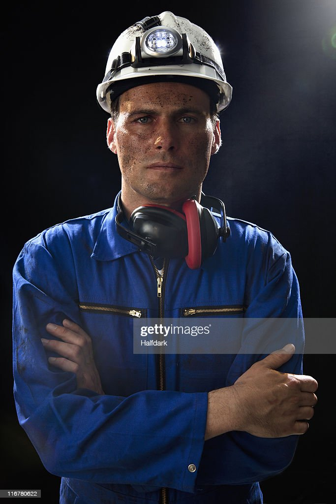 A coal miner with his arms crossed, portrait, waist up