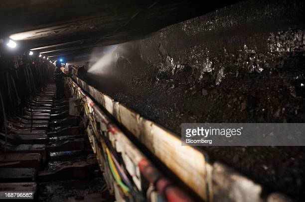 A coal miner works in a longwall mining tunnel at the Consol Energy Bailey Mine in Wind Ridge Pennsylvania US on Tuesday May 14 2013 Coal's prospects...