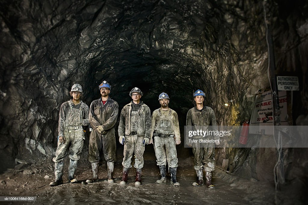 Coal miners in front of mine shaft