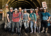 Coal miners in front of mine shaft, portrait