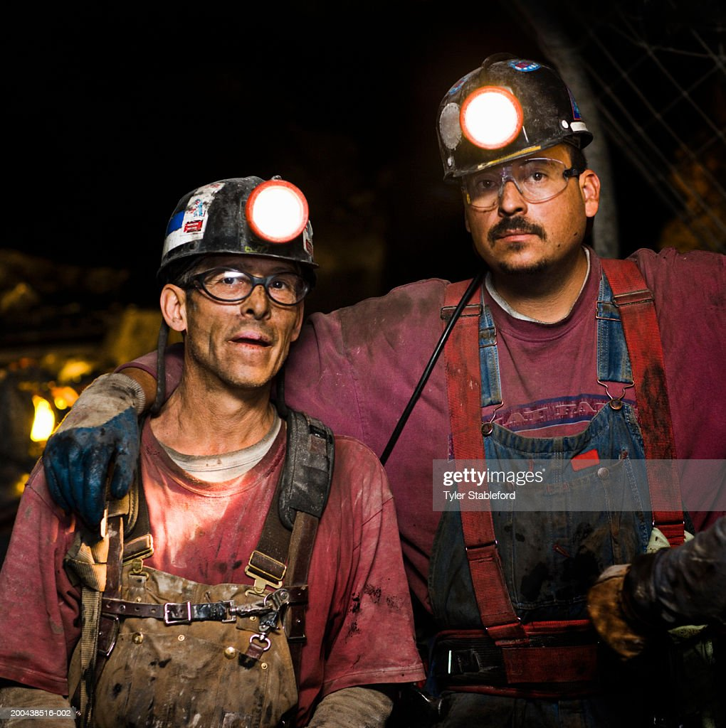 Coal miners in mine shaft, portrait, close-up