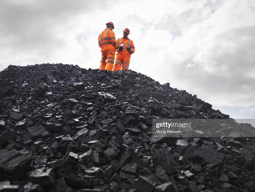 Coal Miners On Pile Of Coal