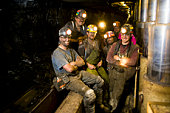 Coal miners smiling, portrait