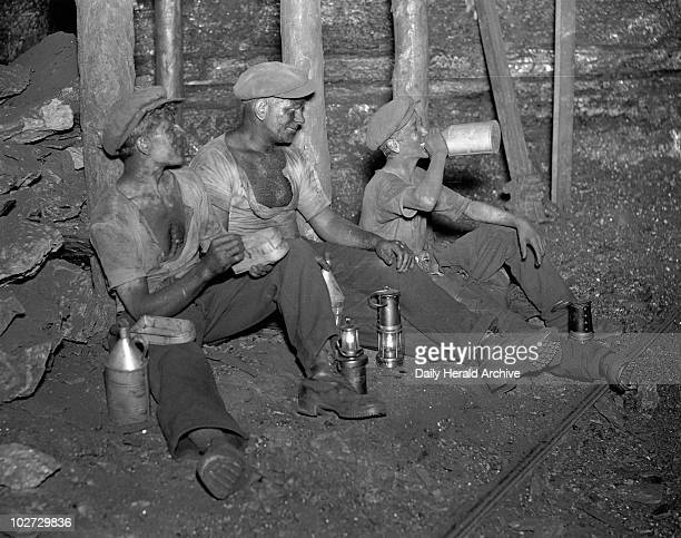 Coal miners taking their twenty minute rest South Wales 24 June 1931 Photograph by James Jarche taken for a series of articles in the Daily Herald...