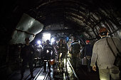 Coal miners wait for the elevator to leave for the day at Scheglovka Glubokaya mine on March 3 2015 in Makeevka Ukraine While Ukraine's economy has...