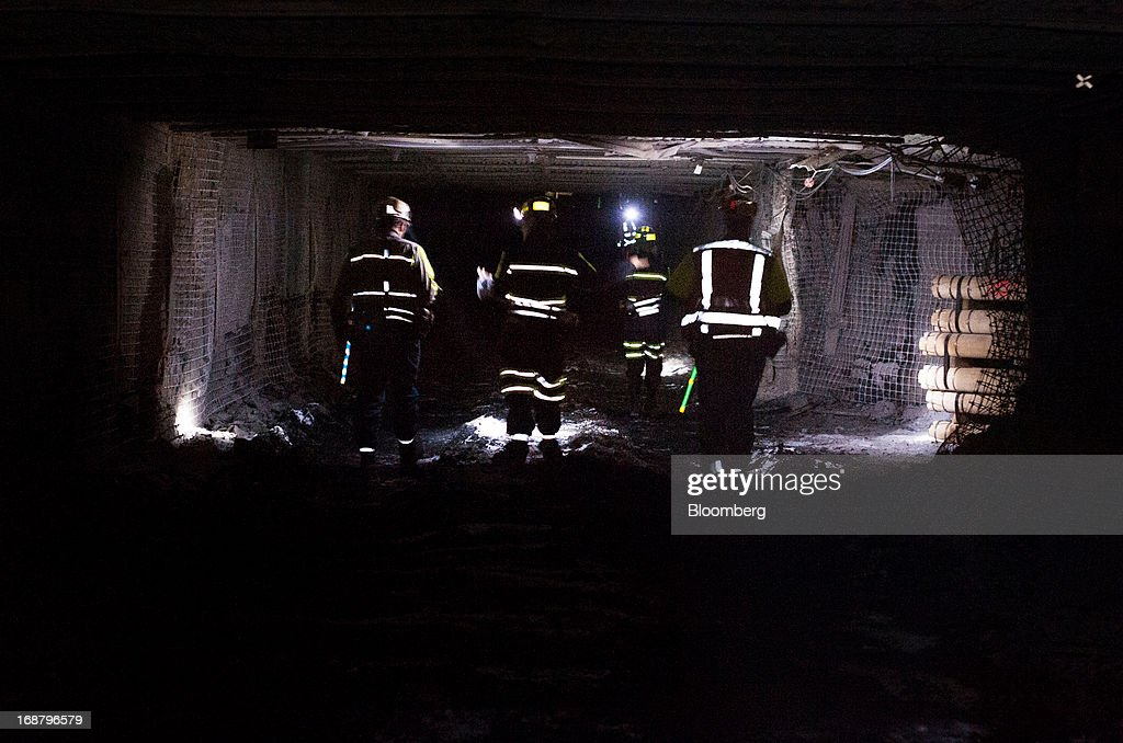 Coal miners walk through a tunnel at the Consol Energy Bailey Mine in Wind Ridge, Pennsylvania, U.S., on Tuesday, May 14, 2013. Coal's prospects are improving after its share of U.S. power generation fell last year to 34 percent, the lowest since at least 1973, Energy Department data show. Hotter temperatures this summer that prompt American households to use more air conditioning will boost demand for coal and the railroads that ship it. Photographer: Ty Wright/Bloomberg via Getty Images