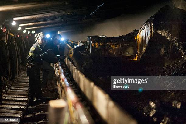 Coal miners watch as a carbidetipped shearer scrapes coal from the wall during longwall mining operations at the Consol Energy Bailey Mine in Wind...